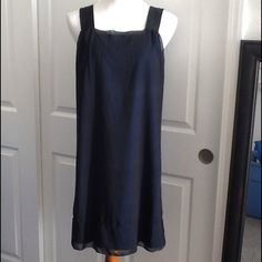 NWT LBD chiffon shift NWT : black chiffon shift dress with blue slip. Delicate detail trim on hem and thick canvas straps for a modern look. 35 inches long Carole Little Dresses