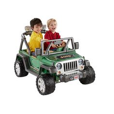 "Fisher-Price Power Wheels Deluxe Jeep Wrangler Drives on hard surfaces and grass • High speed lock-out for beginners – Parent-controlled • Power-Lock® Brakes • Includes 12-volt battery and charger • Requires 4 C batteries for radio and 4 AA batteries for lights- Power Wheels (Fisher-Price) - Toys ""R"" Us $299.99 Ages 3-4 Years."