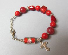 On Sale, CROSS Rose Lamp work, Red Bracelet with cross dangle, rose & 10 mm beads of various sizes shapes. Handmade Bracelets, Handmade Jewelry, Beaded Bracelets, Toddler Crafts, Vintage Gifts, Lampwork Beads, Bracelet Making, Red Roses, Handmade Items