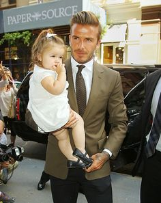 David Beckham melted hearts all over the globe as he arrived at his wife, Victoria's fashion show at Mercedes-Benz Fashion Week in New York with daughter Harper in his arms on September 9. The 14-month-old, who has been to more fashion shows than most grown-ups, was front and centre with her dad to support her mum's latest collection – which has been receiving rave reviews