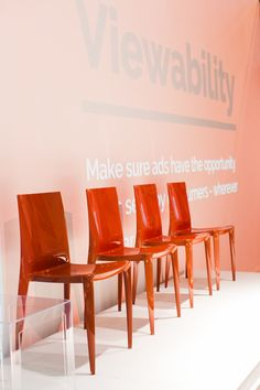 These amazing red chairs were perfect for adding a bold color to the space #corporate #event #conference #branding #planning #panel #speakers
