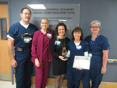 Sarasota Memorial's Nursing Division is very happy to announce our newest DAISY award recipient, Tina Parkes, BSN, RN, Cardiac Cath Lab! Jan Mauck, Chief Nursing Officer, was there to present Tina with this prestigious award, along with some of Tina's coworkers. (l to r: Mike Walker, Jana Putnal, Jan Mauk, Tina Parkes, Nancy Olson). Congrats, Tina! (Feb 2015)
