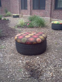 "Recycled tire seat for outdoor classroom. Treated plywood,  2 inch foam, clear vinyl then covered with outdoor fabric. All stapled underneath. Screwed 3 little ""legs"" to bottom of plywood that sit down in the tire like a plug of sorts. This keeps the seat top in place. Stinking adorable!"