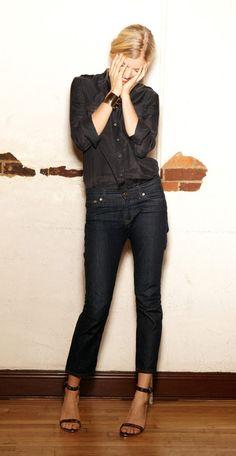 Black shirt, dark jeans.