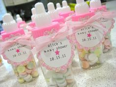 baby shower favors to make yourself | Pink baby bottles with smarties and adorable labels made by me :)