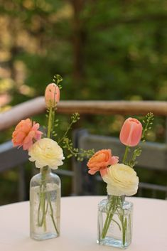 Different flowers, but this style for the little bottles on the dinner tables? Maybe even put our hands on blue glass and milk glass?