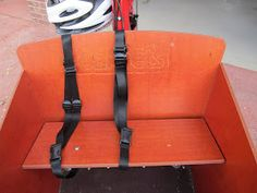 My kid outgrew the infant car seat , but wasn't quite ready to sit on his own on the bakfiets bench, so a bobike mini can be used to help t...