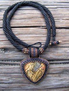 Spiral Herringbone Necklace With Cherry Creek Jasper Pendant: Lori uses a twisted tubular herringbone rope with a peyote beaded cabochon.