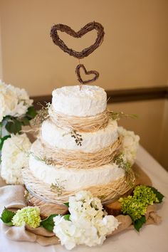 Rustic cake with handmade vine heart topper -