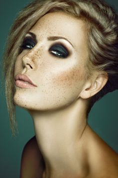 Black Smokey Eyes, Pale Lips, and Freckles. Editorial Makeup.