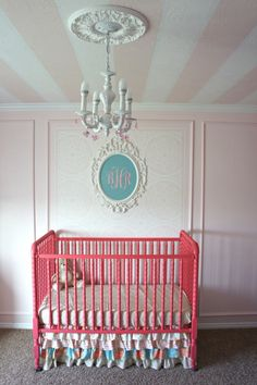 framed monogram | stripes on the ceiling | light fixture | ruffled crib skirt