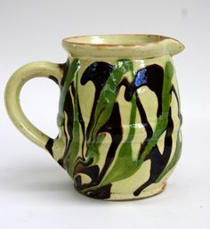 Mochaware Marbled Slip Decorated Redware Pitcher, United States, ca. 1800.