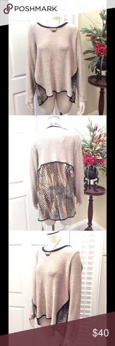 Taupe leopard top Beautiful taupe brown and black leopard high low top. Brand new with tags.  Sleeves measure 26 inches. Bust is 22 inches across. Top front length is 26.5 inches. Back length is 29 inches. poeme by citron Sweaters Crew & Scoop Necks