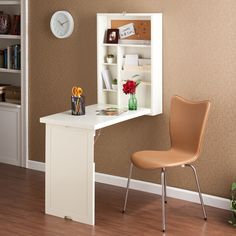 An ideal solution for any room, this winter white writing desk folds away neatly and compactly. Fold the desk down and you reveal a convenient storage area with two adjustable shelves, bill organizers and a corkboard. Whether you choose to use this in your home office, living room, bedroom or dorm, you are sure to be pleased with the amazing functionality of this fold out desk.