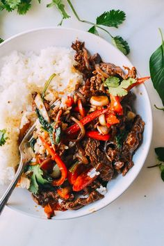 Thai Basil Beef (Pad Gra Prow) Thai Basil Beef, or Pad Gra Prow, is an easy, delicious dish of stir-fried beef and thai basil. Thai Basil Beef over white rice is a perfect meal. Asian Recipes, Beef Recipes, Cooking Recipes, Healthy Recipes, Thai Beef Recipe, Indonesian Recipes, Healthy Thai Food, Tasty Thai, Tilapia Recipes