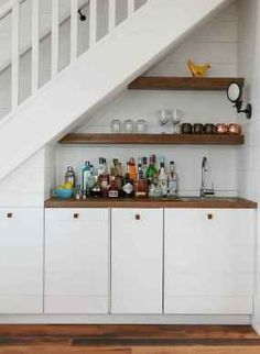 Wet Bar under stairs. Wet Bar under staircase. Built in wet bar under the stairs with floating shelves and shiplap cabinets and shiplap paneling. Wet Bar under the stairs Jennifer Worts Design Inc Cabinet Under Stairs, Bar Under Stairs, Kitchen Under Stairs, Space Under Stairs, Shelves Under Stairs, Bar Shelves, Staircase Storage, Stair Storage, Staircase Design