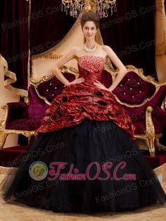 Exquisite Red and Black Quinceanera Dress Strapless Zebra and Tulle Hand Made Flowers Ball Gown http://www.fashionos.com Take a walk on the wild side in this fabulous zebra-inspired dress. It features a strapless which does not lack of Stability and sex yet elegance. The gorgeous skirt is made from many scraps of various colored scraps, which add to its beauty, fullness and lovely shape. Dreamful ruffles and ruched him make the wearer like the fairy from the flowering shrubs.