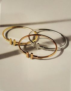 Tiffany -- Tiffany T Wire Bracelets in 18kt White, Yellow and Rose Gold with Diamonds.