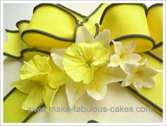 Learn how to make Gum Paste Flowers.  Daisy, Gerbera, Daffodil & Calla Lilly