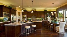 Marseille Kitchen - dark wood cabinets, light granite countertops