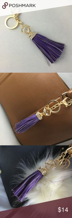 Purple Tassel Purse Charm,Key Chain, w/Rhinestones Accessorize your handbag with this purple faux leather tassel charm. Gold tone clasps and rhinestone trim. Looks great by itself or paired with a fur pom pom ball. (available in my other listings)  New without tags. Bundle for a discount. I ship within 1-2 days. Accessories Key & Card Holders