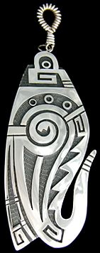 This highly artistic pendant by Trinidad Lucas, is all about Germination and Growth along with water symbols a prayer feather and migration pattern. Hopi