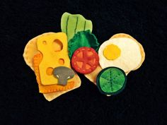 Felt play sandwich and fillings - bread, cucumber, tomato, cheese, mushroom, lettuce, and egg.