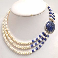 3 strand pearl necklace with 7.5mm white freshwater pearls alternating with 7mm lapis beads and silver tone clasp. Beautiful idea!!