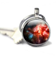 Space Keyring - Deep Space Art, Red Explosion Key charm, gift for a friend,. £9.99, via Etsy.