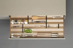 buthaup b3 interior fitting system in oak finish with stainless steel dividers, cutlery block and fitted spice jars. www.bulthaup.com #bulthaup #kitchens #modernkitchens