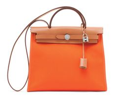 An orange toile officier and naturelle hunter leather herbag zip