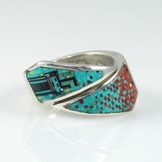 Ring | Irene and Carl Clark (Navajo).  Sterling silver with  Microfine Inlaid Turquoise, Coral, Jet and Lapis Stones.