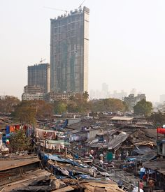 The haves and the have-nots in Mumbai. The skyscrapers that reach the sky and the zodiphattis that are below. But without either, that city would not survive.