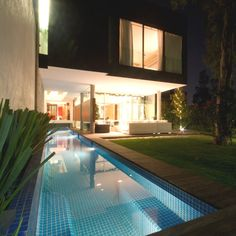 Large Block House with Pool: Perfect Outdoor Pool With Blue Tiling Completed With Accent Lighting Under Water For Brilliant Look At Night Swimming Pool Waterfall, Swimming Pool Landscaping, Natural Swimming Pools, Swimming Pool Designs, Natural Pools, Backyard Pools, Backyard Landscaping, Backyard Designs, Landscaping Design