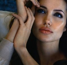 Angelina Jolie looking great but almost android with professional makeup and lighting, an airbrush or Photoshop (we all have pores), and a nose remade by a plastic surgeon