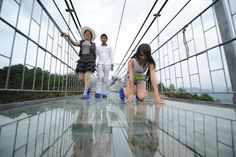 On August 20th, China opened to the public the world's longest and highest glass-bottomed bridge. It's a feat both in engineering and in human nature to terrify ourselves. The bridge clocks in at 1,400 feet across and hangs suspended about 950 feet above a sheer drop in the mountains in the Zhangjiajie, Hunan Province. These …