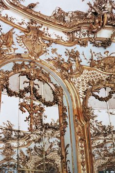 As Rococo as a wall gets: mirrors and stucco glop completely obscuring tectonic articulation (where does the wall end and the ceiling begin?), not to mention the considerable thickness of the bearing wall, which now seems to be made out of nothing but frilly decoration.