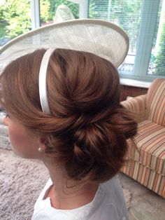 Messy low bun sat slightly to the side - twisting sections of hair in - looks great with this hat