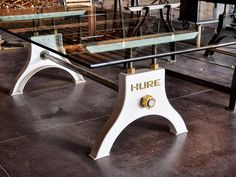 Available in an array of sizes to fit most table tops Various colors available including color matching Base pictured is made for an 8' top Glass and Reclaimed oak top shown Each base says Hure on the face. Read about the Hure story here: LINK