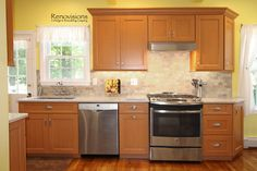 A recent kitchen renovation by Renovisions. Wood cabinetry, quartz countertops, brushed nickel hardware, stainless steel appliances, stainless steel sink, undermount sink, hardwood floors, stone backsplash, natural backsplash, tile backsplash, marble look countertops, open feel, warm and inviting.