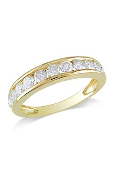 1 CT Diamond Eternity Ring In 10k Yellow Gold. (Looks like mine, only mine is Platinum and 1.5 ct in diamonds.)