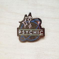 Inspired by neon signs of the southwest. Our Psychic lapel pin features a high polished gunmetal finish with contrasting pastel enamel fills. 1.25 tall and comp