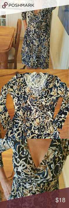 Printed Wrap Dress with Acrylic Hoop Accent Black background with cream, tan, light and dark blue abstract floral pattern. Fax marble (acrylic) hoop accent at waist. Can be tied on the side or in back. Slight defect in acrylic, not noticeable at all. Dresses Midi