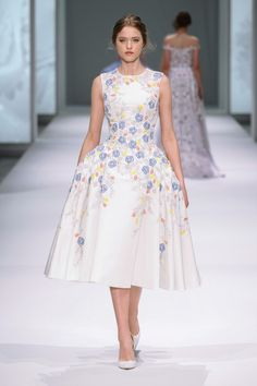 White silk faille dress with structured pleats and silk chiffon, thread and crystal hand embroidery.