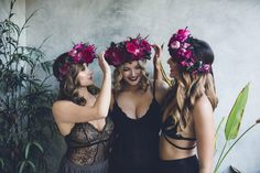 bridesmaids getting ready wearing magenta flower crowns