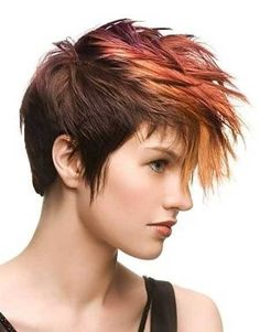 Brown shade with orange and auburn in bangs. Pixie cut.