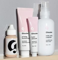Glossier Phase 1 Set includes Milky Jelly Cleanser, Priming Moisturizer, Balm Dotcom, and Perfecting Skin Tint $80