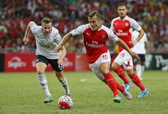 On the run: Arsenal's Jack Wilshere and Tom Cleverley of Everton