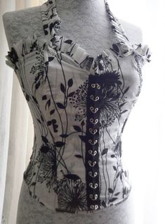 df7ed2af97 Pretty corset   bustier in cotton with floral design in black on off white  background It