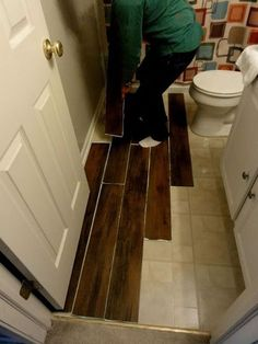 A Grace Full Life: Master Bathroom Makeover-Cover existing floors with these planks from Lowes for about $55. Make a template and you don't have to remove the toilet to do.